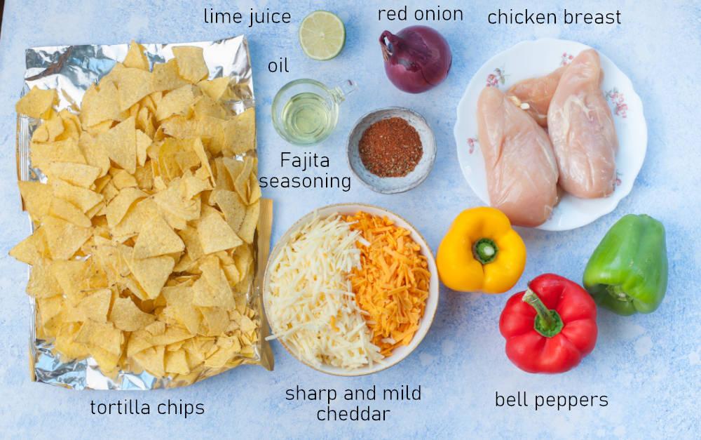 Labeled ingredients needed to prepare chicken fajita nachos.