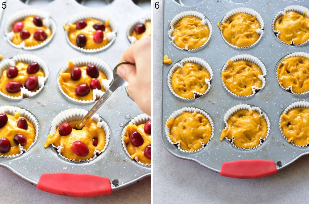 Cranberries are being submerged into pumpkin muffin batter.