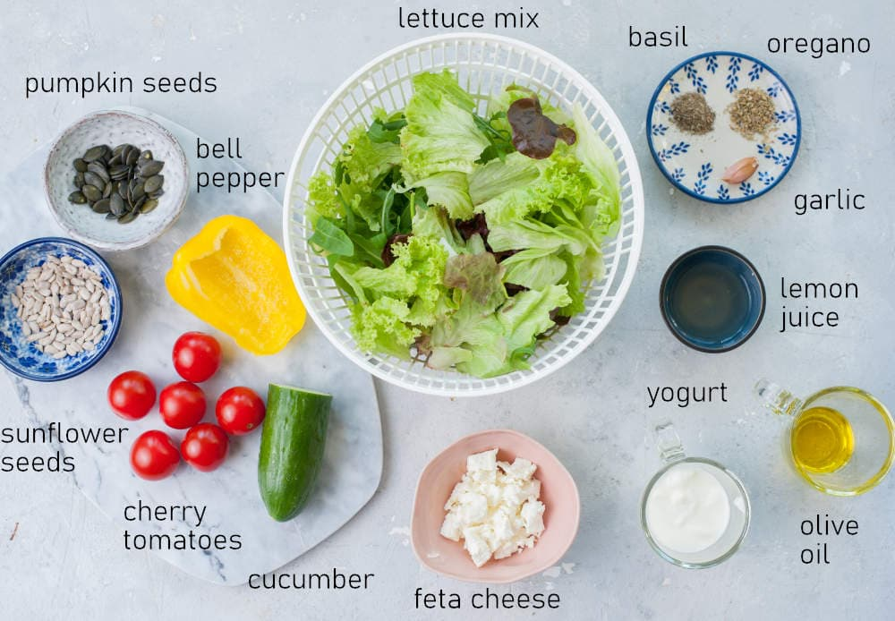 Labeled ingredients for salad with yogurt dressing.